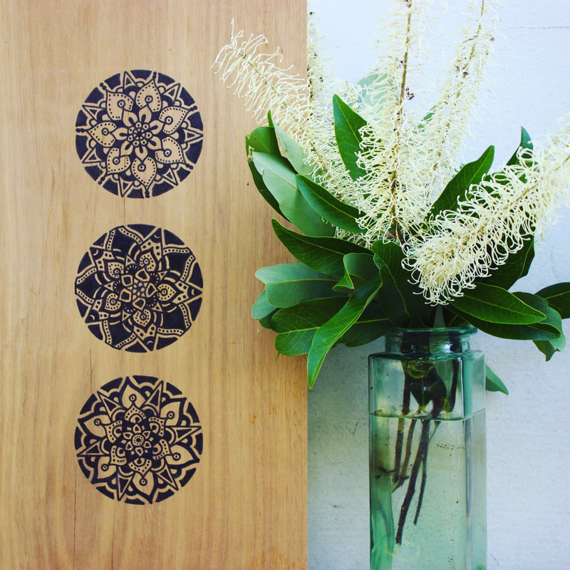Sustainable homewares - black mandala artwork on timber