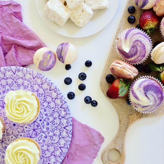 Jacaranda mandala plate paired with purple linen tablecloth and sweet treats