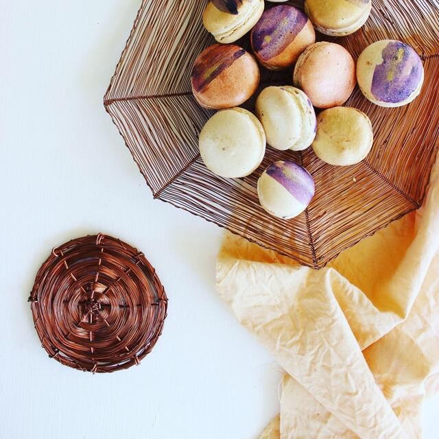 Copper honeycomb plate paired with homemade macarons and honey coloured linen napkins