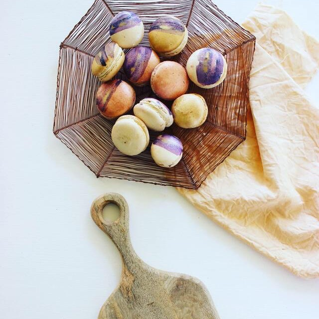 Honey coloured napkins made with organic textiles paired with macarons