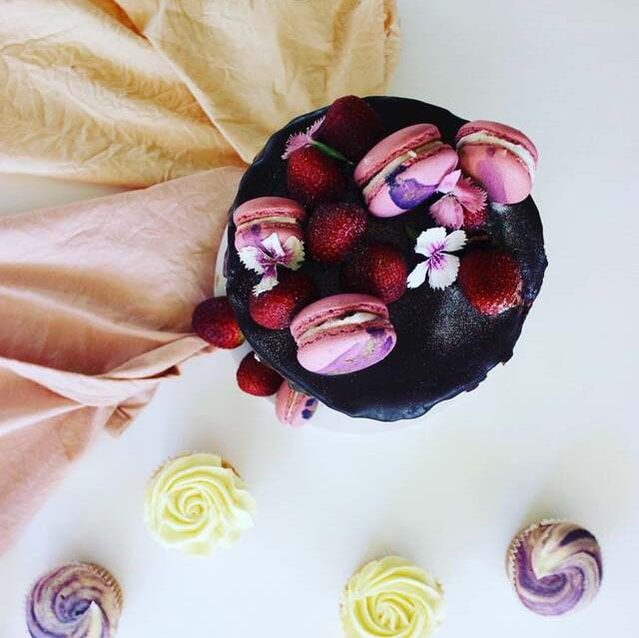 Earth friendly tablecloths styled with chocolate ganache cake and fresh fruit