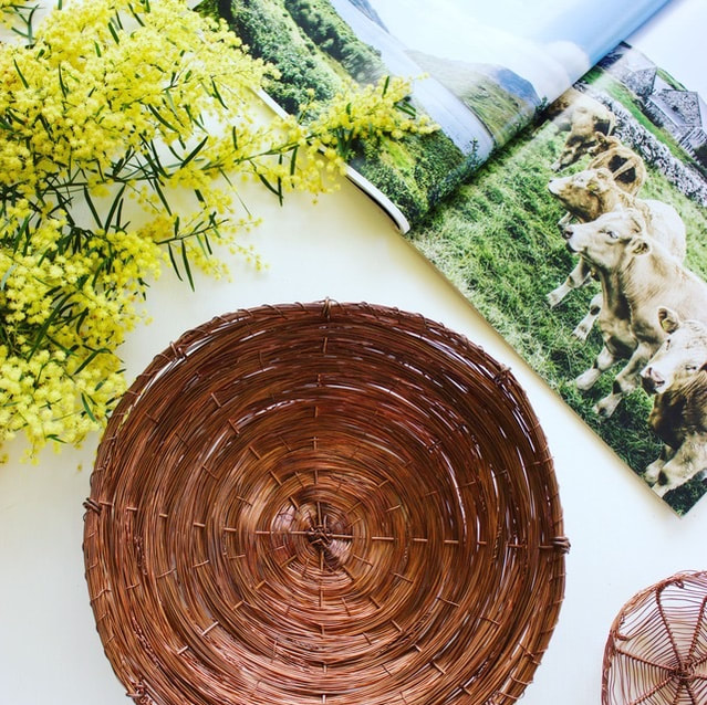 Handcrafted tableware surrounded by Australian wattle and country style inspiration