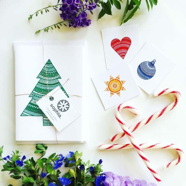 Stylish Christmas cards paired with beautiful decorations