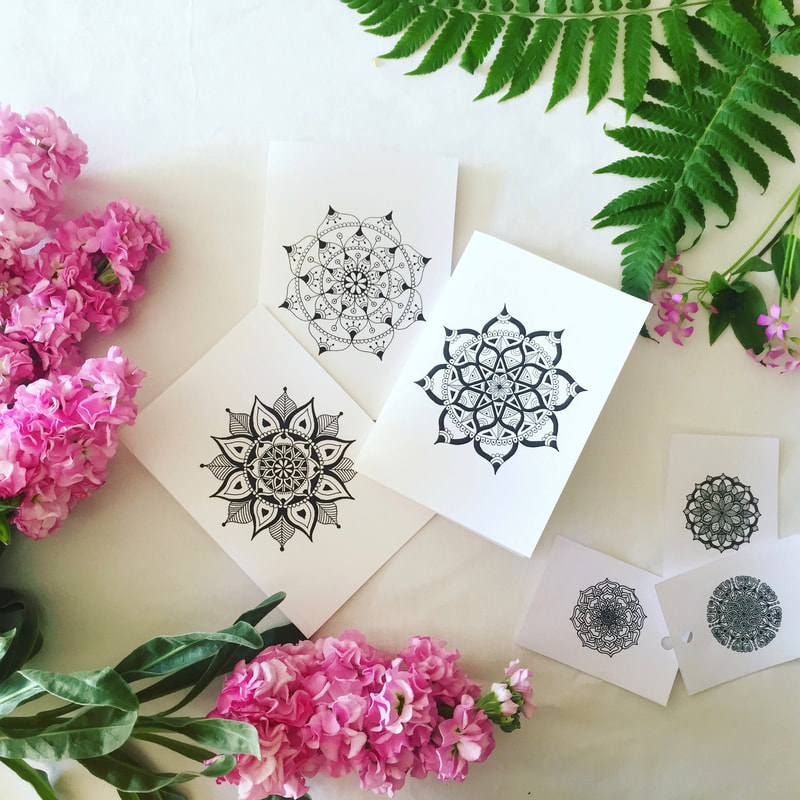 Beautiful black and white gift cards styled with pink flowers