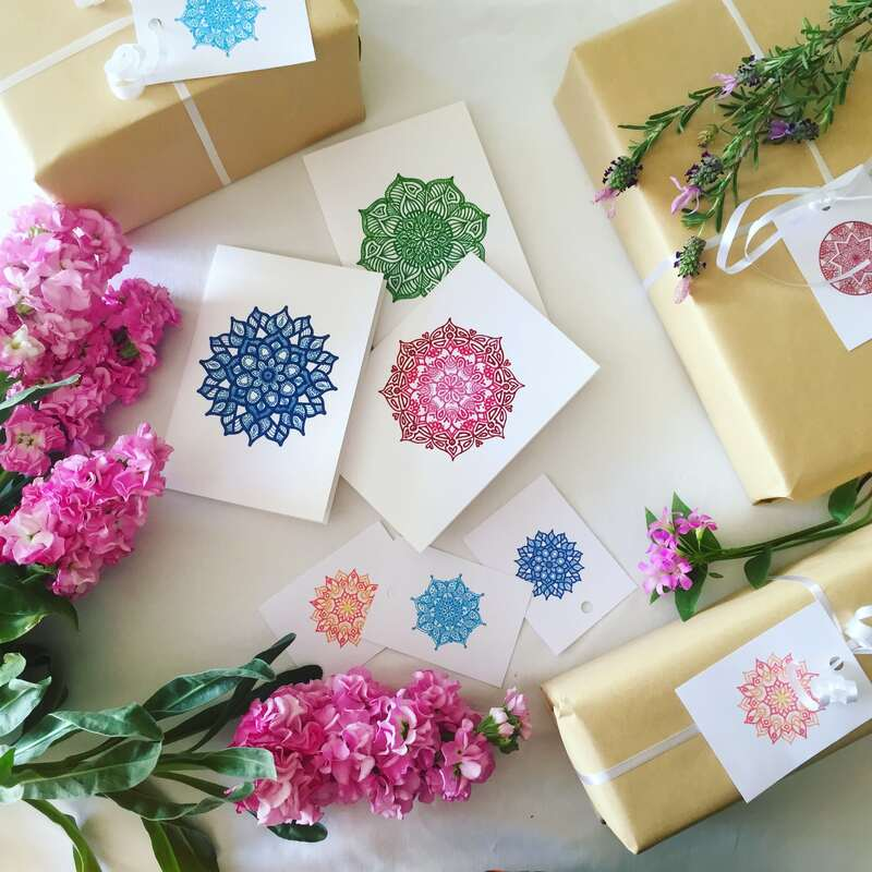 Pretty gift tags tied around bunches of fresh and colourful wildflowers