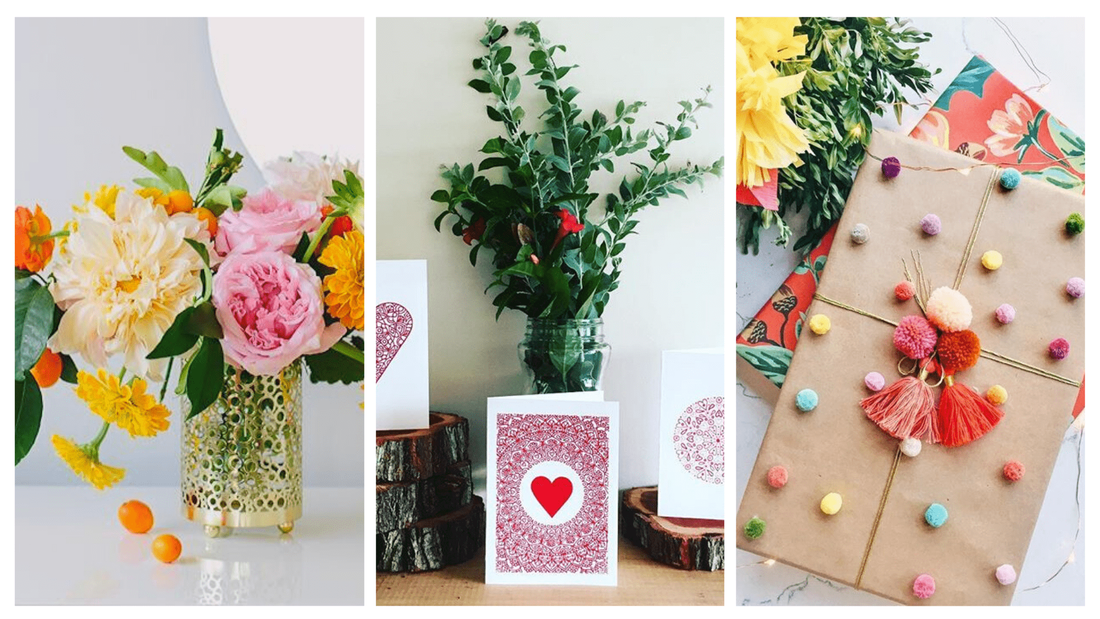 Bright blossoms and golden sunflowers styled with beautiful gift cards and eco-friendly presents