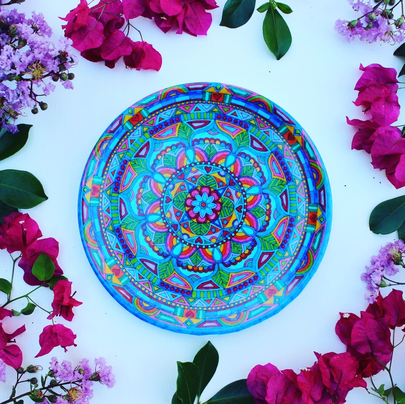 Moroccan design - eco dinner plates surrounded by flowers