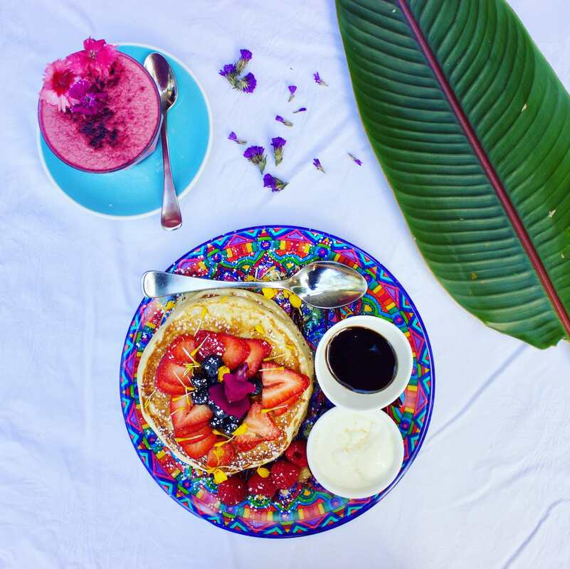 Mystique plate piled high with pancakes and fresh berries