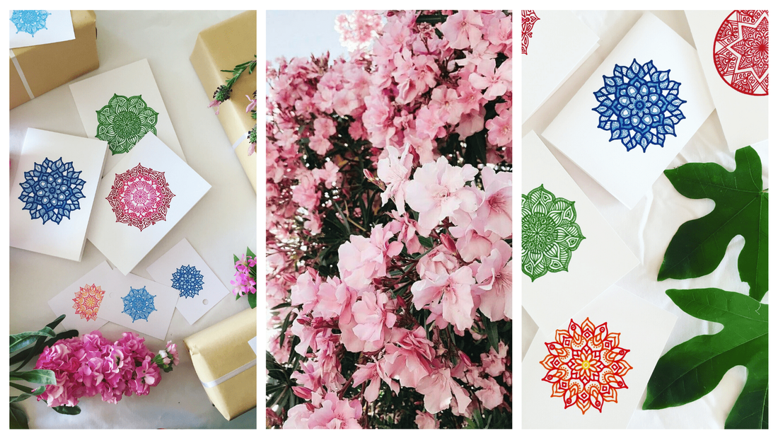 Interesting cards that have been styled with pretty greenery and colourful flowers